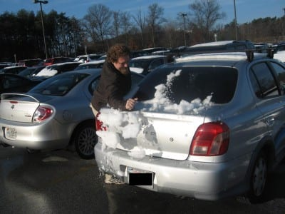 ben with snow on car