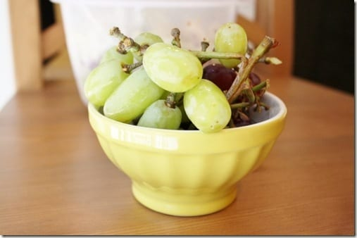 grapes in yellow bowl