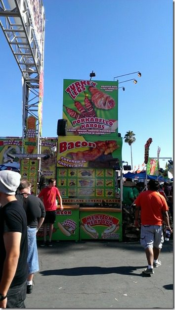 bacon covered turkey leg stand at fair (450x800)