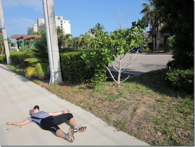 dead runner on sidewalk